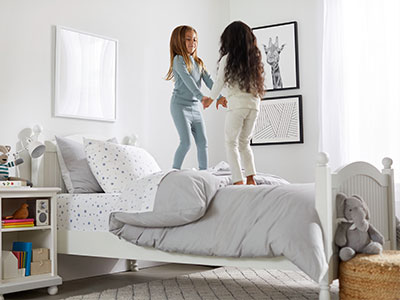 Two sisters playing in their new room.